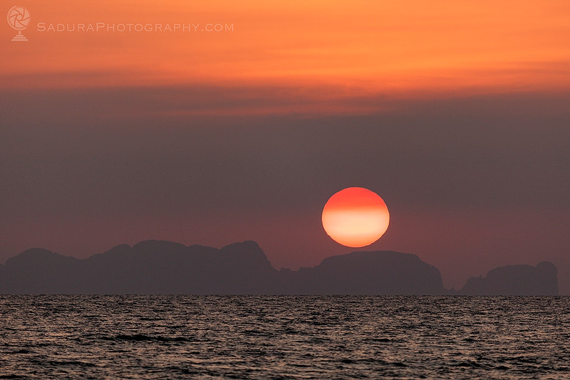 Sun setting above Phi Phi Islands in Thailand