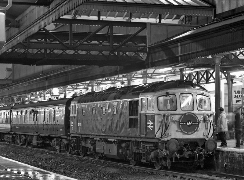 33101 at Exeter St Davids with 1Z10, a railtour organised by Woking Homes, on 3rd October 1987. The days itinerary cosisted of, 33101 Woking - Alton, 31874 and 506 Alton- Alresford and return, 33101 Alton - Paignton, via Guildford, Reading and Bristol, 7827 Paignton - Kingswear and return, 33101 Paignton - Woking, via Exeter and Salisbury. Scanned Negative.