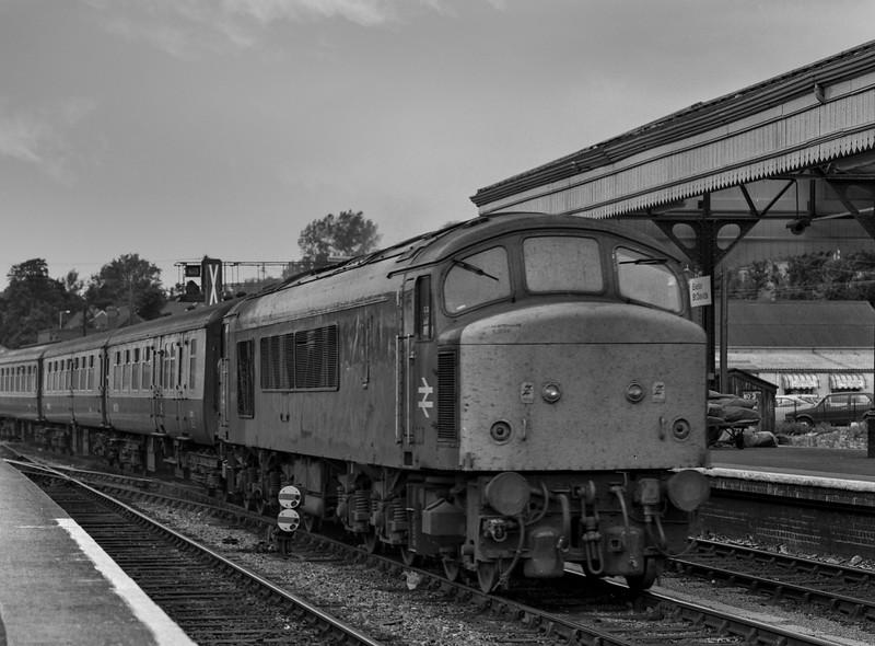 45148 passes through Exeter St Davids with 1V81, the 09:21 Leeds - Penzance, <br /> on 1st September 1984. Scanned Negative.