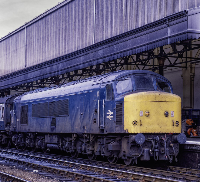 46011 at Exeter St Davids with 1V73, the 09:11 Manchester Piccadilly - Newquay, <br /> on 29th September 1984. Scanned Transparency.
