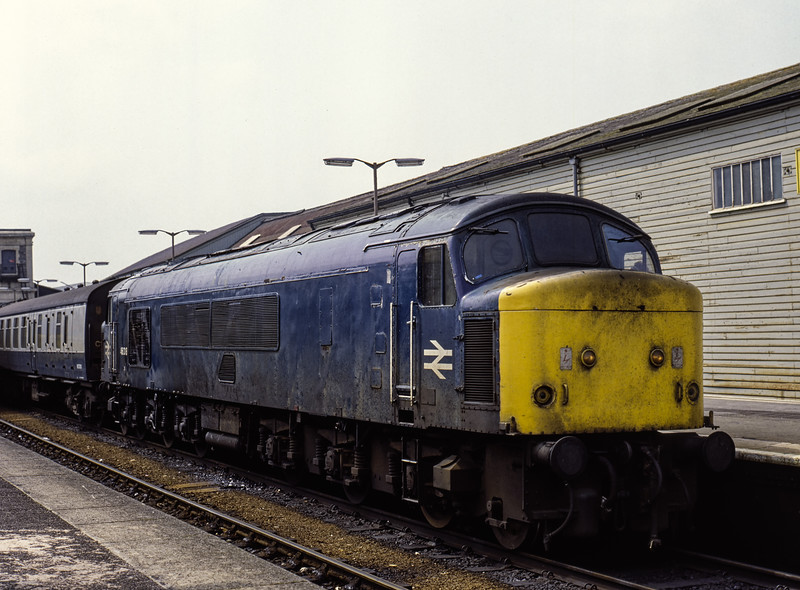 46018 at Exeter St Davids with 1M76, the 08:55 Newquay - Manchester Piccadilly, <br /> on 25th June 1983. Scanned Transparency.