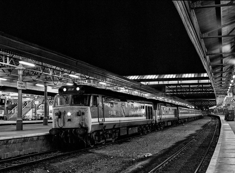 """50002 """"Superb"""" and 50044 """"Exeter"""" at Exeter St Davids with 5V17, <br /> the 20:50 Exeter St Davids - Laira, on 11th September 1990. This was the ECS from 1V17, <br /> the 17:15 from Waterloo. Scanned Negative."""