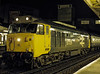 "50026 ""Indomitable"" at Woking with 1V19, the 19:10 Waterloo - Exeter St Davids, <br /> on 5th March 1983. Scanned Transparency."