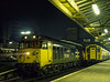 "50046 ""Ajax"" at Woking with 1V19, the 19:10 Waterloo - Exeter St Davids, <br /> on 10th November 1984. 4-VEP No. 7734 is on a Waterloo - Guildford service. <br /> Scanned Transparency."