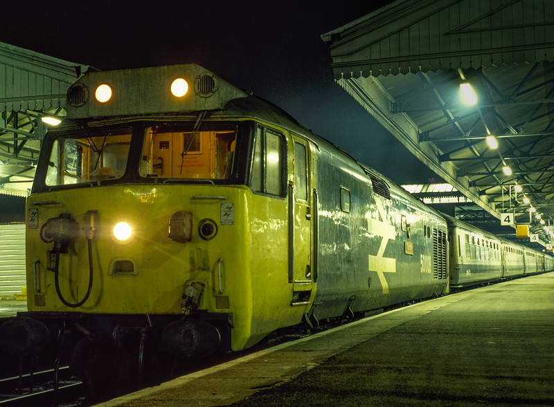 """50008 """"Thunderer"""" at Exeter St Davids with 2O96, the 20:24 service to Basingstoke, <br /> on 28th December 1984. Scanned Transparency."""