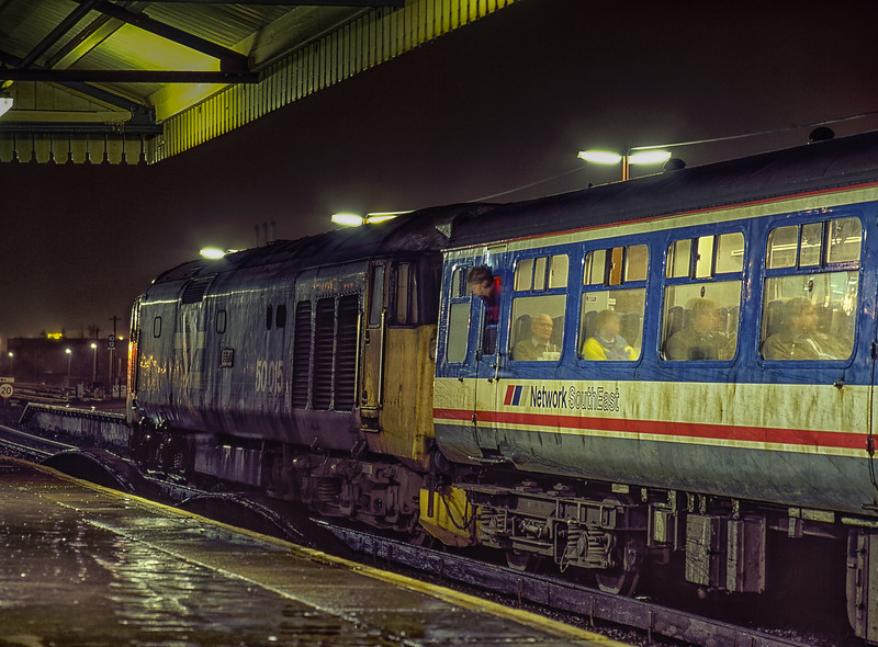 """50015 """"Valiant"""" at Basingstoke with the 16:40 Waterloo - Salisbury, on 28th December 1990. Class 50 availability must have been low that day, as 50015 was a Departmental loco in the DCWA Pool. Scanned Transparency."""