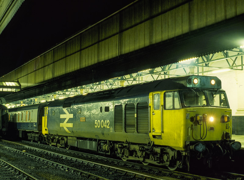 """50042 """"Triumph"""" at Exeter St Davids with 1V90, the 10:45 Glasgow - Penzance, <br /> on 28th December 1984. Scanned Transparency."""