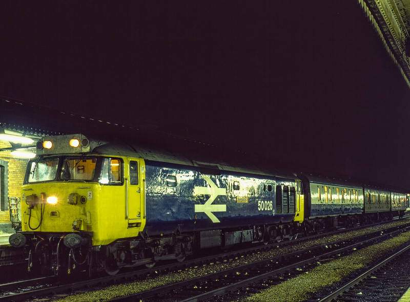 """50026 """"Indomitable"""" at Reading with 3M15, the 20:50 Paddington - Birmingham Vans, <br /> on 20th August 1984. Scanned Transparency."""