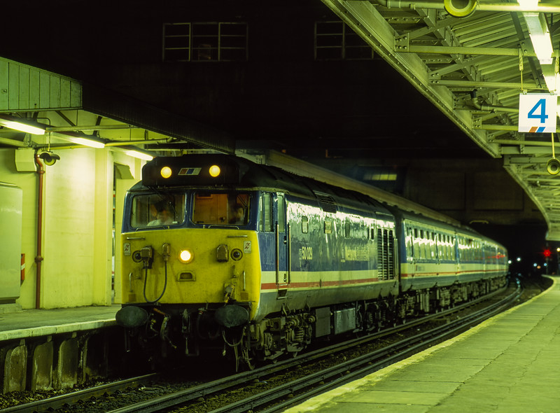 """50029 """"Renown"""" at Woking with 1Z40, the 17:22 Waterloo - Sherborne, on 28th October 1990. This was  a Sherborne Schools Relief. Scanned Transparency."""