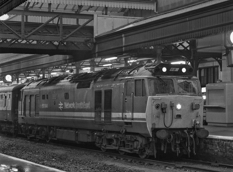 """50044 """"Exeter"""" at Exeter St Davids with 1O24, the 18:17 to Waterloo, on 3rd October 1987. Scanned Negative."""