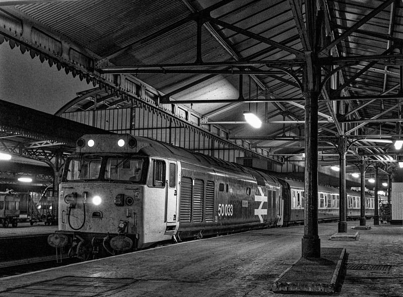 """50033 """"Glorious"""" at Paddington with 1C56, the 17:07 to Hereford, on 5th November 1983. <br /> Scanned Negative."""