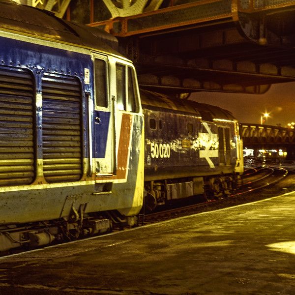 """50020 """"Revenge"""" with the 18:12 Paddington - Hereford and 50025 """"Invincible"""" with the 19:09 Paddington - Oxford. Both shown at Paddington on 2nd January 1988. <br /> Scanned Transparency."""
