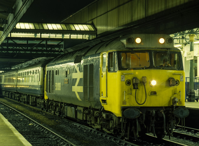 """50008 """"Thunderer"""" at Exeter St Davids with the ECS for 2O96, <br /> the 20:24 service to Basingstoke, on 28th December 1984. Scanned Transparency."""