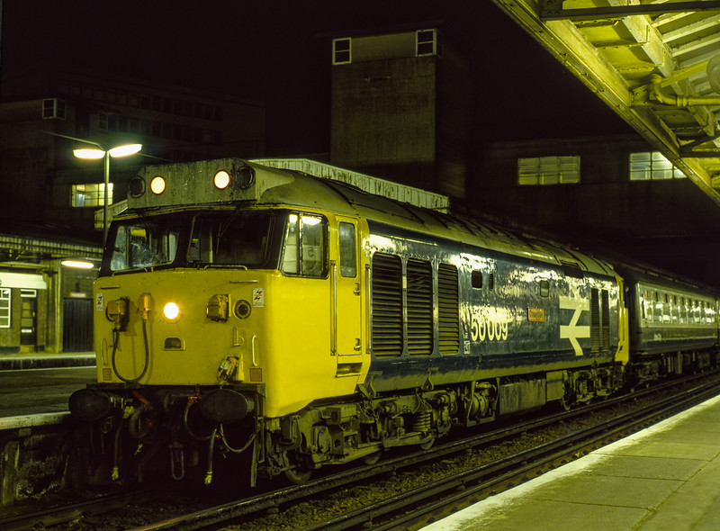 """50009 """"Conqueror"""" at Woking with 1L09, the 20:10 Waterloo - Salisbury, on 16th April 1983. Scanned Transparency."""