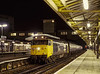 "50031 ""Hood"" at Woking with 1V19, the 19:10 Waterloo - Exeter St Davids, <br /> on 30th January 1982. Scanned Transparency."