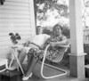 Wilson Connell Related_Marguerite Moughnahan Parents on Mrs Phelps porch