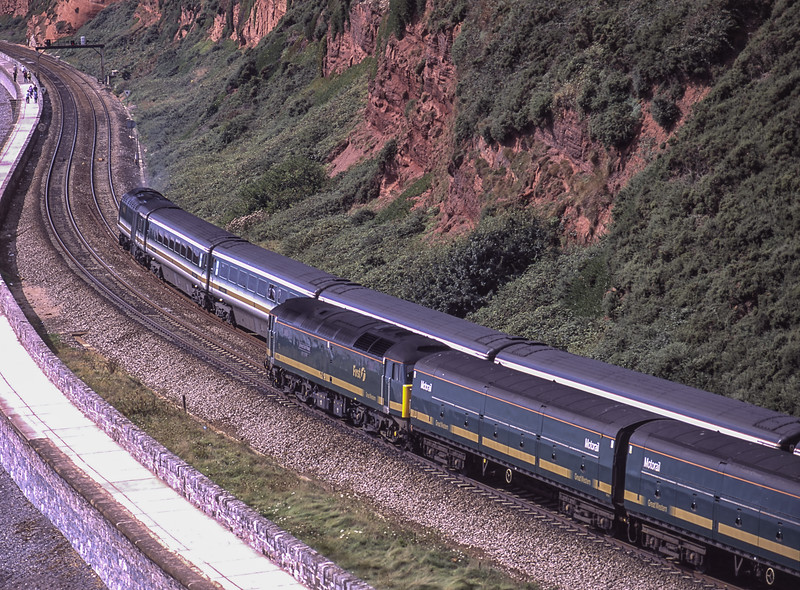 """47816 """"Bristol Bath Road Quality Approved"""" heading towards Dawlish with 1C17, <br /> the 09:30 Paddington - Penzance, which included Motorail Vans in the consist, <br /> on 1st September 2001. The HST set is working up with 1A50, <br /> the 11:38 Paignton - Paddington. Scanned Transparency."""