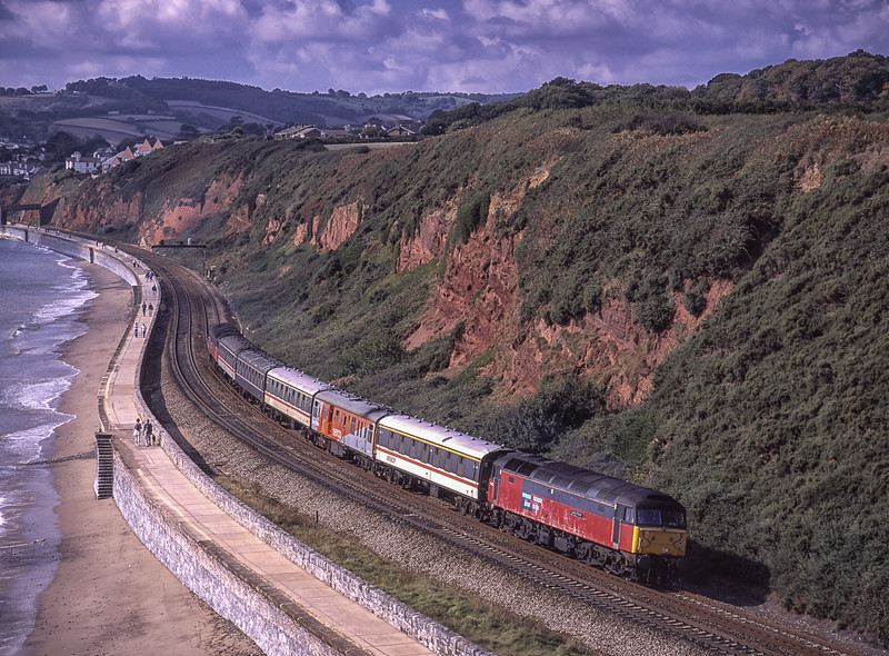 """47783 """"Saint Peter"""" top & tail with 47749 """"Atlantic College"""" on the Sea Wall at Dawlish Warren with a Serco Test Train, on 20th September 2001. Scanned Transparency."""