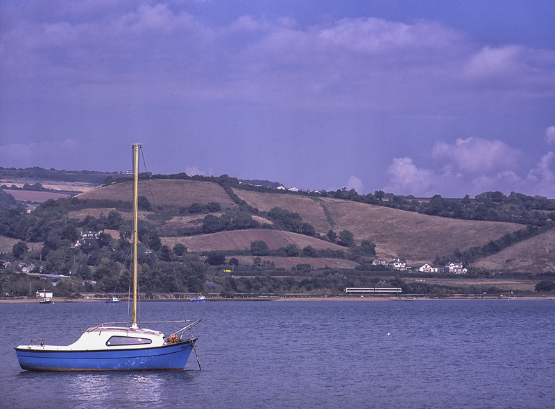 An unidentified class 158 unit, runs along the Teign Estuary, <br /> with the 11:00 Cardiff - Penzance, on 25th September 2001. Scanned Transparency.