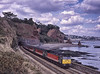 """47814 """"Totnes Castle"""" at Horse Cove, Dawlish, with 1V46, the 09:13 Liverpool - Plymouth, <br /> on 20th September 2001. Scanned Transparency."""