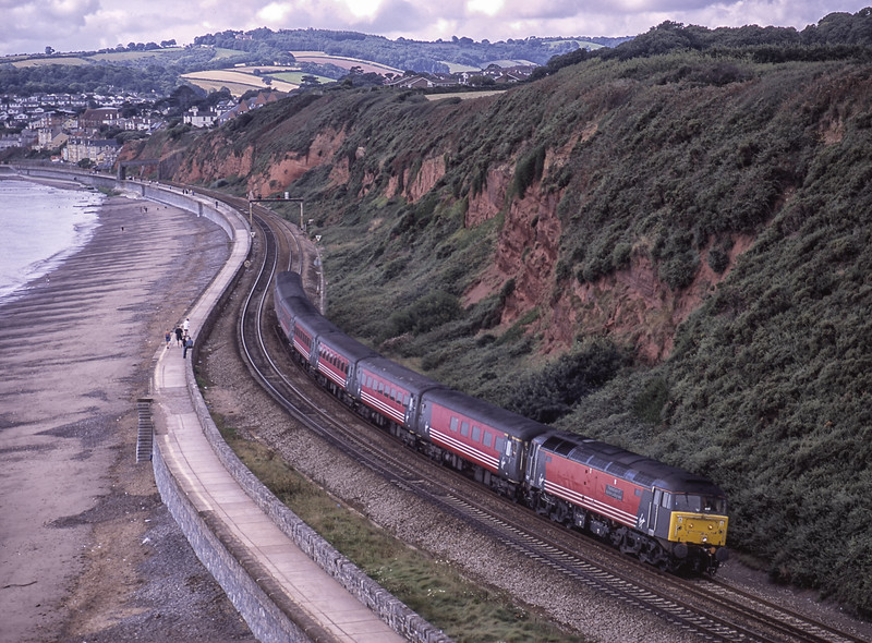 """47817 """"The Institution of Mechanical Engineers"""" on the Sea Wall at Dawlish Warren, <br /> with 1E33, the 10:02 Paignton - Newcastle, on 1st September 2001. Scanned Transparency."""