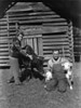 """Mrs. F. O. """"Willie"""" Baker and tenant, Jack Stinson, with twin calves, born November 25 and December 2, 1946."""
