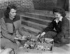 Ruby Ingram and Dorothy Guthrie, February 1947<br /> <br /> The Atlanta Constitution, Thursday, February 20, 1947<br /> 4-H POULTRY PROJECT - Ruby Ingram (left), Home Demonstration Agent, and Dorothy Guthrie, or Poplar Springs School, look over some chicks sent Berrien County 4-H Club members.