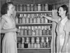 Ruby Ingram and Mrs. Julian Rowan - August 1947<br /> <br /> The Atlanta Constitution, Sunday, August 10, 1947<br /> FOOD FOR THOUGHT? - Mrs. Julian Rowan, of Poplar Springs community, right, displays some of the 396 quarts of vegetables and fruits she has canned this season and discusses some points on canning with Ruby Ingram, Berrien County Home Demonstration Agent.  South Georgia farm families really have been busy this Summer after the Extension Service in Athens issued a warning on food preservation for Winter.  Considerable canning in Berrien County was done by 4-H Club members.