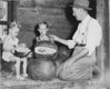 Nan and Don Williams and Walt Young, June 1947<br /> <br /> The Atlanta Constitution, Sunday, June 22, 1947<br /> MELONS ARE MOVING - South Georgia watermelons are beginning to move to market, with premium prices up to $750 a box car.  Walt Young, Berrien County farmer, paused while loading his second car of melons last week to sample one with Nan Williams (left) and her brother, Don, of Nashville, Ga.  From his 12 acres Young plans to load a third car Monday, getting in good early season shipments.