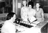 """LUCILLE ROBERTS, GERALDINE GRINER & GEN HACKET PRESENTS SONNY BARFIELD AT WNGA RADIO  A VFW AUXILIARY AWARD.<br /> <br /> The Berrien Press, page 12, June 14, 1973<br /> VFW AUXILIARY AWARD -- For """"continued outstanding service to the community,"""" Sonny Barfield of radio station WNGA was presented a certificate of merit by the Ladies Auxiliary of Post 5978 of Veterans of Foreign Wars.  Making the presentation was Mrs. Geraldine Griner, center, outgoing president, with Mrs. Lucile Roberts, left, recently elected president, and Mrs. Gin Hackett, chairman of several committees which Barfield had benefitted with publicity."""