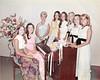 group around piano 1970s