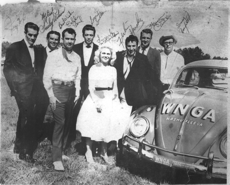 Promotional news print of WNGA Radio, Nashville, GA.<br /> Pictured are Jerry H., Smiley Wilson, Eddie Bond, Leon Sutton, Kitty Wilson, Ferlin Husky, Hanson Carter, Sonny Barfield. Courtesy of John M. Browning