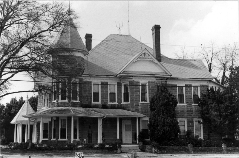 The Carter-Clark house viewed from the east side in 1972. Note fret work decoration on gable and finials on cupola which have since been removed. Also note the lightening rods which have since been removed. Railings around the porch have since been added. Chimney at the rear of the house has since been removed. Photo by Peggy Tygart.
