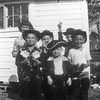 Photo in the late fifties, taken in Nashville of cousins playing cowboys. Front row left to right: Wesley Harrell, Franklin Harrell, Jack Connell. Back row left to right: Mary Alice Connell, Jacky Harrell, Johnny Harrell. The Harrell boys are the children of Wilbur & Nan Harrell while the Connells are the children of Flem & Mary Connell. Photo courtesy of Jack Connell.