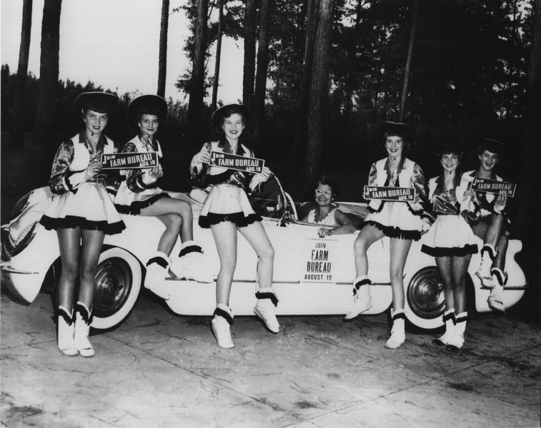 Hazel Vickrey Dance group, circa 1954. L-R:  Barbara Jean Jackson, Janice Ray, Patsy Thomas, Hazel Vickrey, ?, June Hughes, ? (Courtesy of Hazel DeShields Vickrey and Billy Cornelius)<br /> The Nashville Herald, front page, August 19, 1954<br /> RENEWING FARM BUREAU MEMBERSHIP CARDS - The Rockettes, a group of lovely Nashville teen-age girls, have been busy today helping the Berrien County Farm Bureau with membership renewals.  Left to right, Barbara Jean Jackson, Janice Ray, Patsy Thomas, Martha Nell Durrance, June Hughes and Dale McLendon.  The driver is Mrs. Hazel Vickrey. -- Photo by Troy Harsey.