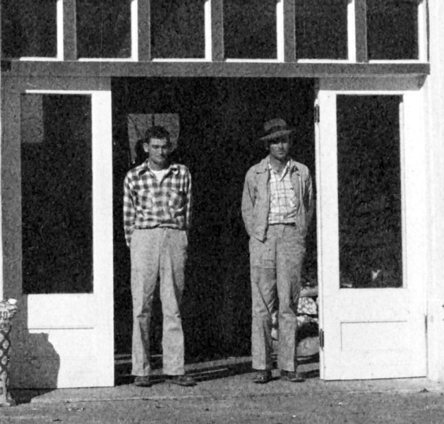 Wilson's Seed and Feed Store on East Marion, detail of men in doorway. Identifications needed.