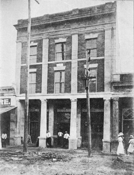 Opera House about the time of its completion on the south side of Courthouse Square. Later remodeled into the movie theater. Perkins Store to the left, Berrien County Bank (later United Bank) to the right. Image taken from newspaper plate by Jamie Connell.<br /> <br /> <br /> Original cutline:<br /> The Nashville Herald, front page, October 25, 1912<br /> Photo caption:<br /> 	The Nashville Herald Building completed this year:  The first three-story building in Nashville or Berrien County; it is 33x90 feet; The first floor is conveniently arranged for The Herald office; the second and third floors are occupied by the new Opera House; one of the prettiest and most modern theaters in the state.