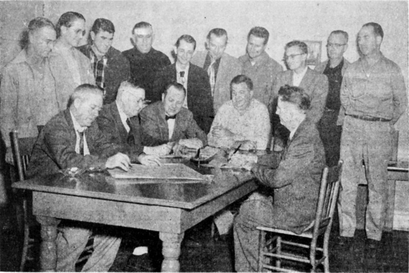The long-sought Nashville swimming pool was realized in 1953 when the Recreation Authority Chairman, John P. Harper, seated second from left, signed the contract authorizing the Caraway Pool and Equipment Company to start construction. The group includes the Recreation Authority and City Council. Seated left to right: A.D. Greene, Mr. Harper, Mayor B. Morris, David F. Caraway, R.M. Connell. Standing left to right: J.D. Tygart, Dr. W.W. Turner, Horace Williams, T.A. Hall, Fred L. Belcher, Roger W. Webb, Robert Drake, Johnny Pat Webb, J. Otis Futch, and R.L. Jackson. Photo by Wink Rogers (original needed).