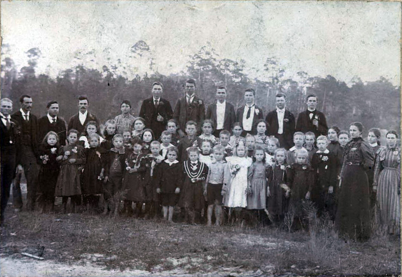 Maybe group of school children or family gathering; was probably taken in late 1890's.  I believe that my Grandfather (Adlai Bee Griner (1892 - 1973)) is in this picture because his name only is on the back of it. Also, probably his friend Jamie Tygart and Bulloch Gaskins are probably there. I know that they were his age and he spoke of them as being his school friends.  I do not know which school he attanded but he always said that they lived 1 mile north of town. Maybe someone can help us identify these folks.<br /> (Information by: Diane Pate; submit information to berriencountyga@windstream.net)