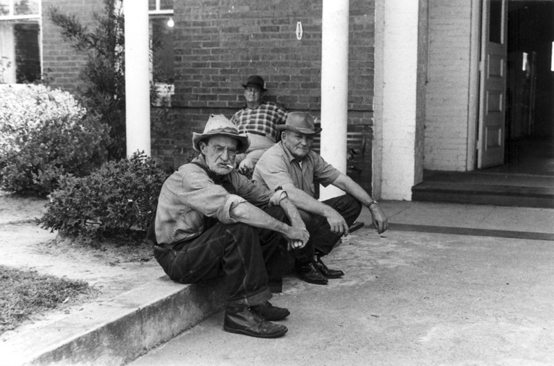 Photo taken at the front of the Berrien County courthouse in 1972. Bill Day (left);  Identifications needed. Photo by Peggy Tygart.
