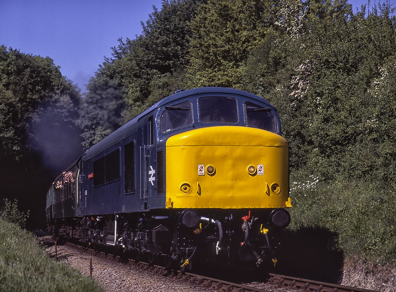 """45060 """"Sherwood Forester"""" exits Sun Lane Cutting, with the 10:25 Alresford - Alton, <br /> on 23rd May 2004. Scanned Transparency."""