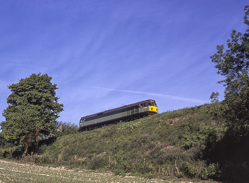 """D444 (50044 """"Exeter"""") approaches Grosvenor Road Bridge, working light engine from Ropley to Alton, on 22nd May 2004. Scanned Transparency."""