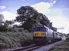 """D444 (50044 """"Exeter"""") approacnig Wanders Crossing, with the 09:36 Alton - Alresford, <br /> on 22nd May 2004. Scanned Transparency."""