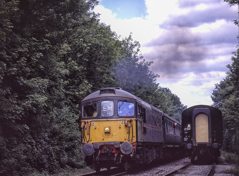 """33103 """"Swordfish"""" at the Meon Loop, with the 14:06 Alton - Alresford, on 22nd May 2004. Scanned Transparency."""