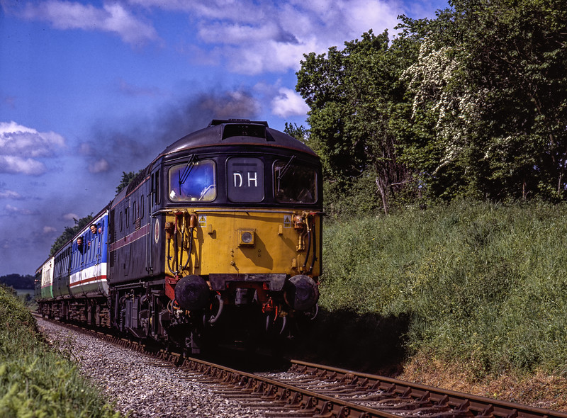 """33103 """"Swordfish"""" approaching Bluebell Crossing, with the 10:25 Alresford - Alton, <br /> on 22nd May 2004. Scanned Transparency."""