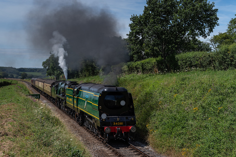 """34081 """"92 Squadron"""" and 34053 """"Sir Keith Park"""" pass the whistle board for Wanders Crossing, with the 12:13 Alresford - Alton, on 7th July 2017."""