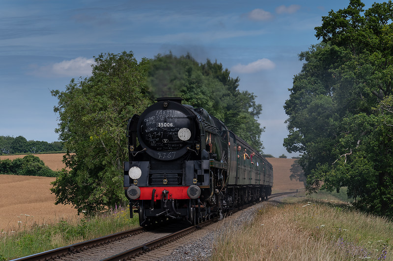"""35006 """"Peninsular & Oriental SN Co"""" about to cross Rookwood Lane Bridge <br /> with the 13:00 Alton - Alresford, on 8th July 2017."""