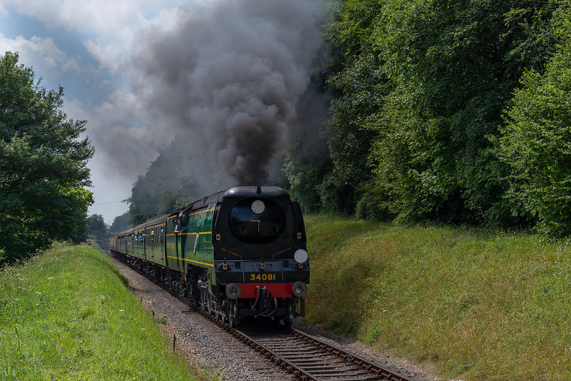 """34081 """"92 Squadron"""" with load 8, climbs away from Ropley with the 13:00 Alresford - Alton, non-stop special working, on 9th July 2017."""