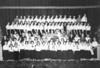 Junior Glee Club 1958-59, photo courtesy Leona Griner<br /> First row, left to right: Patsy Hancock, Shearlie White, Eleanor Pelletier, Joyce Schwartz, Patsy Partin, Linda Wilson, Phyllis Browning, Janice Bridges, Carolyn Keith, Eileen Mixon, Nita Futch, Brenda Cannon, Susan Webb, Helen Whitley, Tommie Sue Daniels, Betty Daniels.<br /> <br /> Second row, left to right: Mrs. Houston, Judy Key, Leona Griner, Mary Jo Hamby, Margaret Ann Giddens, JoAnn Jefferson, Gail Chambliss, Janie Willard, Linda Griffin, Evelyn Richardson, Barbara Ellis, Barbara Kay Hendley, Bonnie Rowe, Sara Faye Swain, JoAnn Hodges, Helen Bartfield, Jackie Luke, Mrs. Griffin.<br /> <br /> Third row, left to right: Wynn Hancock, Dane Perkins, Butch Brown, Franklin Rice, Johnny Hall, Oren Hall, Jerry Griffin, Gilbert Sewell, Chip Yancy, Stanley Vickrey, Earl Wayne Brown, Larry Kent, Hank Snead, Bob Lovein, Tim Scarborough.<br /> <br /> Fourth row, left to right: Jimmy Abney, _________, Ronnie Stone, Jimmy Hunt, Larry Bostick, Charles Earwood, Jerry Hood, Wayne Eaton.<br /> <br /> Fifth row, left to right: Catherine Gaskins, Judy Anderson, Glenna Jo Durrance, Shirley Guest, Aurena Griffin, Derene Akins, Gloria Jean Jaulkner, Mary James, Barbara Brown, Barbara McGill, Sander Johnson, Judy Anderson, Sara Catherine Connell, Sara Lee Rowland, Ann McMillan, Diane Conner, Shirley Pelletier, Janice Warren, Barbara Hutchins, Myra Faye Carr, Judy Miller, Carolyn Lindsey, Martha Kate Rowan, Vivian Moats.<br />  <br /> Sixth row, left to right: Virginia Ray, Jewel Sizemore, Aline Sizemore, Linda Nix, Gail Hancock, Patty Futch, Cheryl Allen, Lynn Futch, Geraldine Cook, Linda Pafford, _________, Leuna Griner, Sandra Pharr, Karlene Holbrook, Mary Gray, Dianne Bradford, Elaine Roberts.