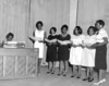 Singing School Teachers, left to right, <br /> Vivian D. Smith Prince at the piano, Music Teacher, Biology, Chemistry;<br /> Jean Kitchen Benjamin, French Teacher, Basketball Coach;<br /> Mary Howard, Middle Grade Teacher;<br /> This person unidentified;<br /> Sue Nell Holmes Owens, Elementary Teacher;<br /> Inez C. Baker, Elementary Teacher;<br /> Lucie V. Spencer Ross, Middle Grade Teacher, also donated property for Beetree Park<br /> Photo identification by Martha Jo West